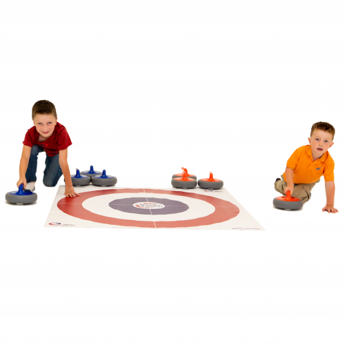 Two smiling children crouching beside a FloorCurl mat while they play a game of Floor Curling.
