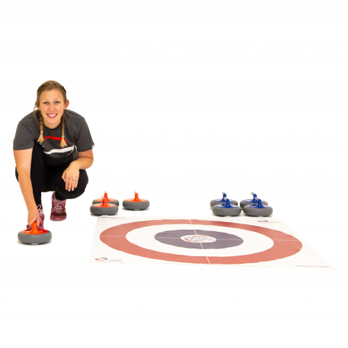 A woman crouches beside a FloorCurl Target Mat and delivers a red stone.
