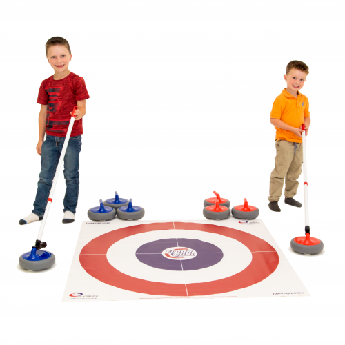 Two children using Pusher Sticks to deliver FloorCurl stones as they stand beside a FloorCurl mat.