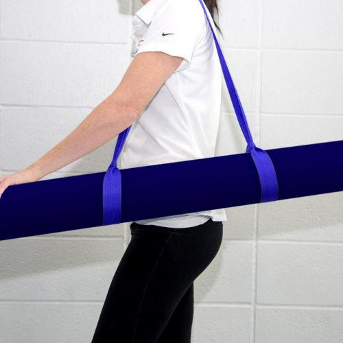 A woman carries a tubular case approximately 4 feet long using a nylon strap draped over her shoulder. The carrying case contains FloorCurl target mats.