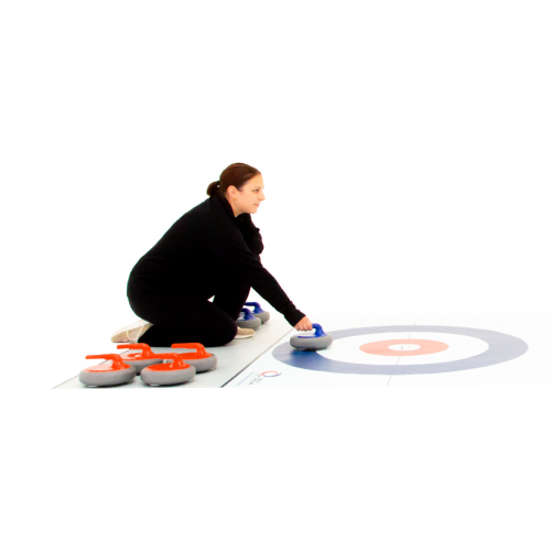 A woman crouches behind a FloorCurl Full Rink Mat and delivers a blue stone by hand.